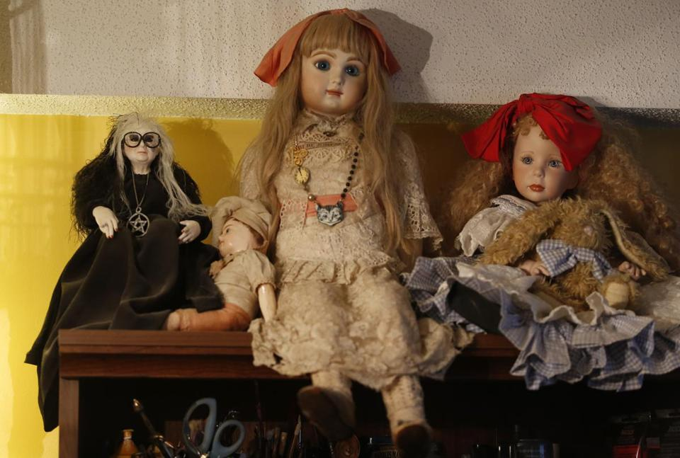 A doll of Laurie Cabot sits on a shelf inside her home in Salem.